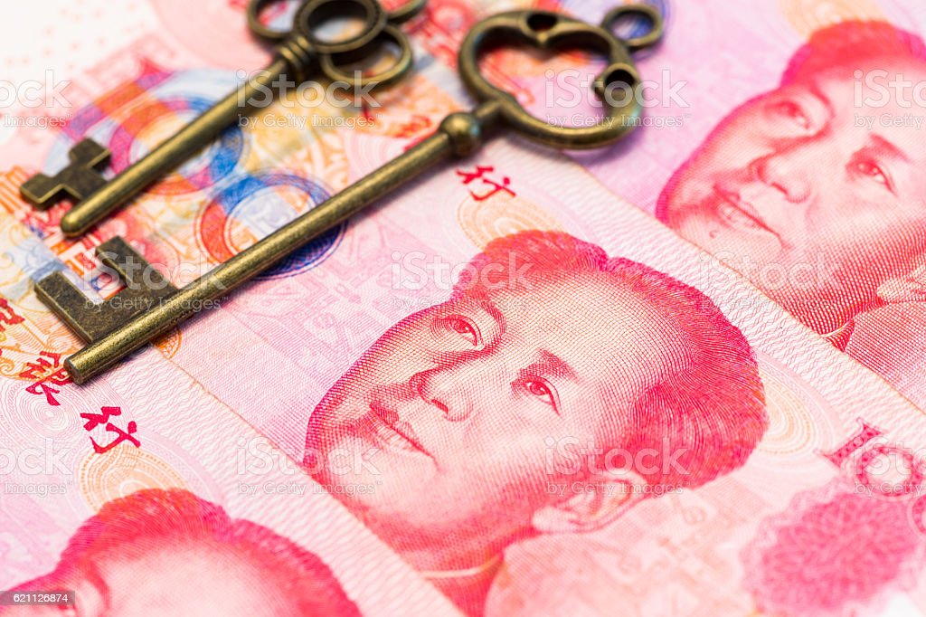 Key on Chinese banknote stock photo
