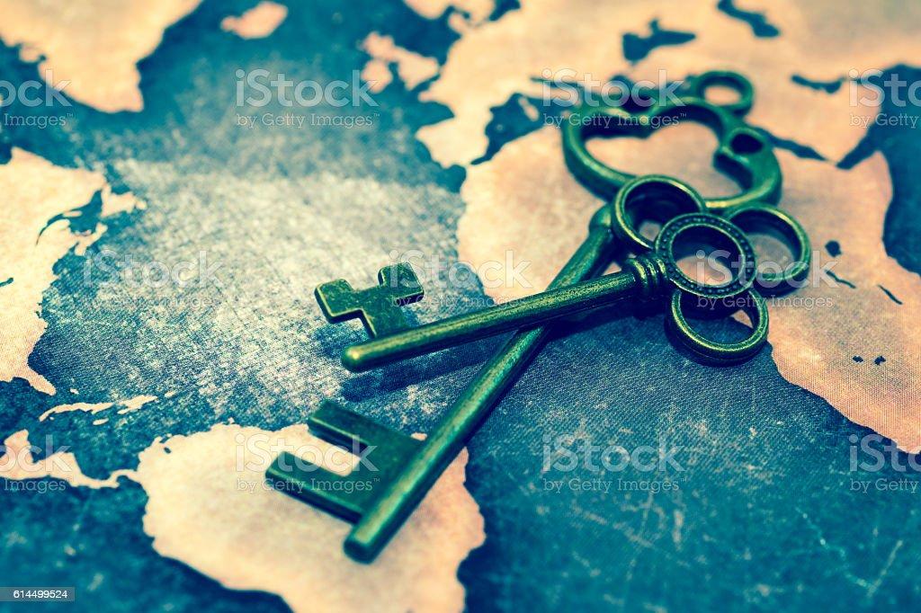 Key on grunge world map stock photo