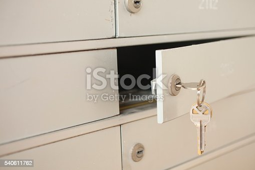 istock Key opening apartment mailbox. Letters inside. 540611762
