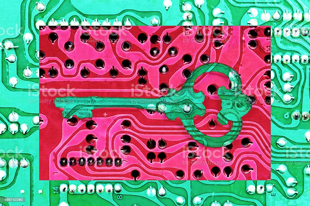 Key shape on Circuit board. Cyber security concept stock photo