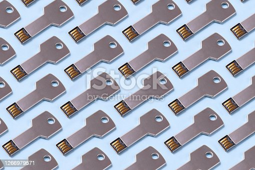 Key shaped usb data disc on blue background