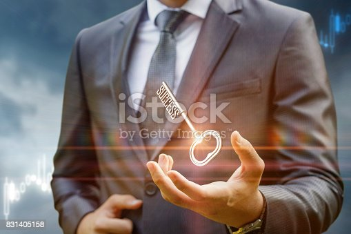 istock Key to success in businessman hand . 831405158