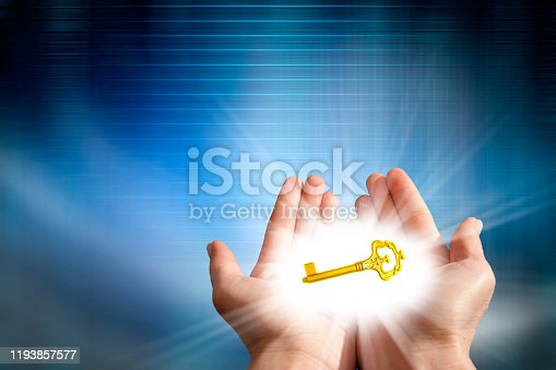 Conceptual success image of golden key and glowing lights in palm of hands over blue abstract light