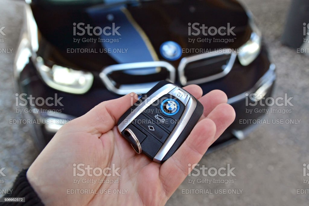 Key to the electric BMW in a hand stock photo