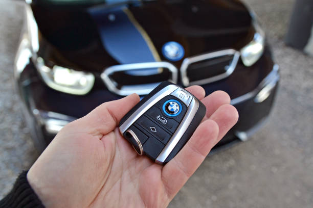 Key to the electric BMW in a hand Bratislava, Slovakia - 24th February, 2018: Elegant and modern key to the electric BMW i3 in a hand. The BMW vehicles are the one of the most popular luxury cars in the world. bmw stock pictures, royalty-free photos & images