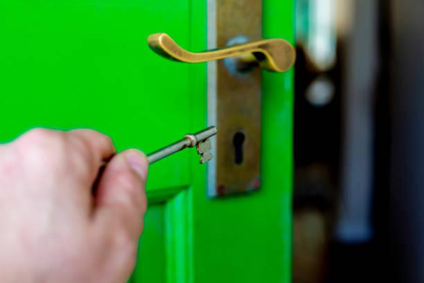 Key unlockes green door stock photo