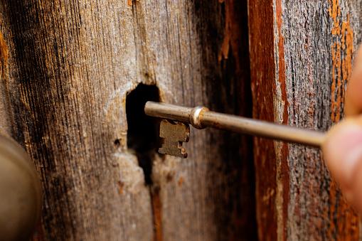 Key unlocks old wooden door