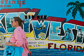 Key West, Florida, United States - August 15, 2018: Image of a woman walking on the streets downtown in Key West, Florida Keys - United States