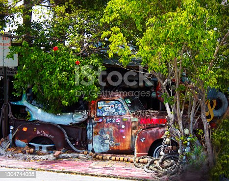 istock Key West Florida USA -Old truck in front of Bos Fish Wagon Resturant 1304744035