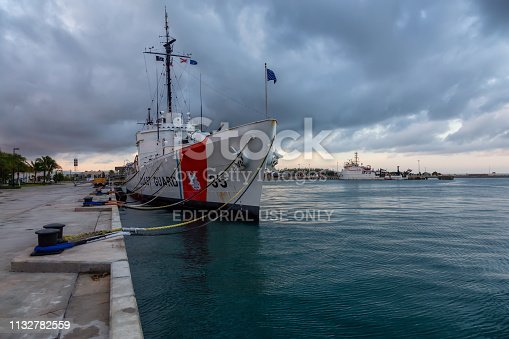 Key West, Florida, United States - November 2, 2018: View of Coast Guard Ship Destroyer at Truman Waterfront Park during a cloudy sunrise.