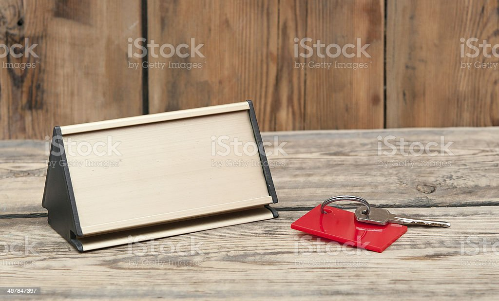 key with blank tag and metal nameplate stock photo