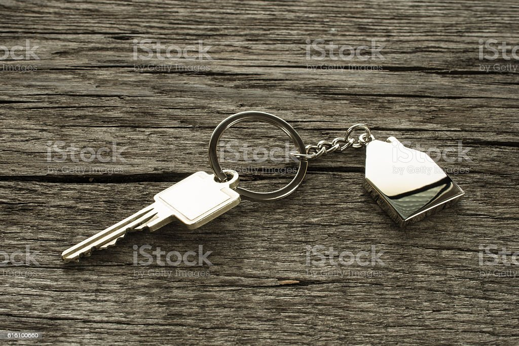 Key with house as key chain stock photo