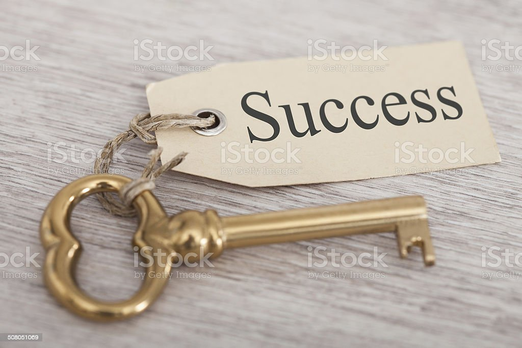 Key With Success Tag On Table stock photo