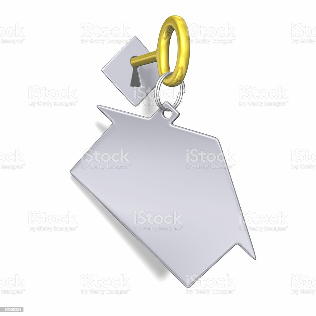 key with trinket in keyhole royalty-free stock photo