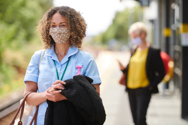 key worker travel with face masks stock photo