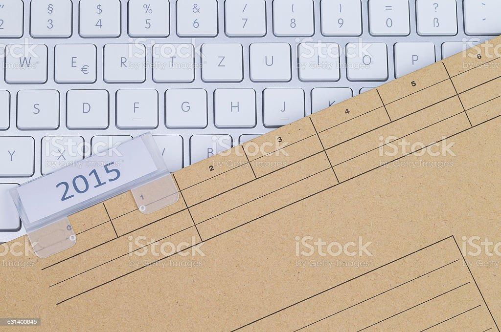 Keyboard and folder 2015 stock photo