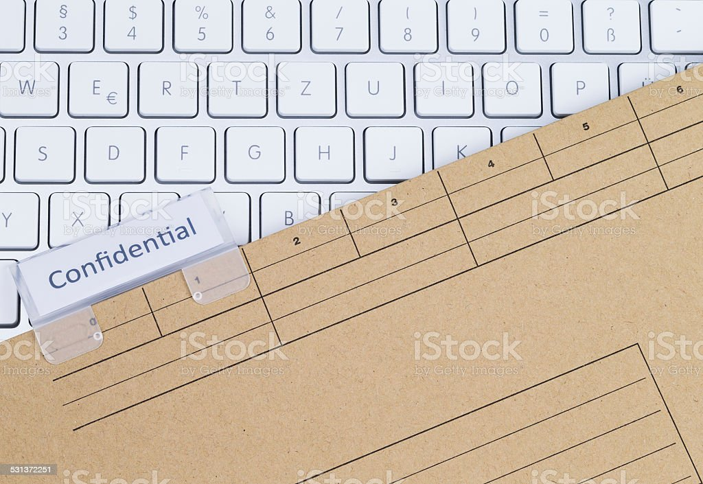 Keyboard and folder confidential stock photo