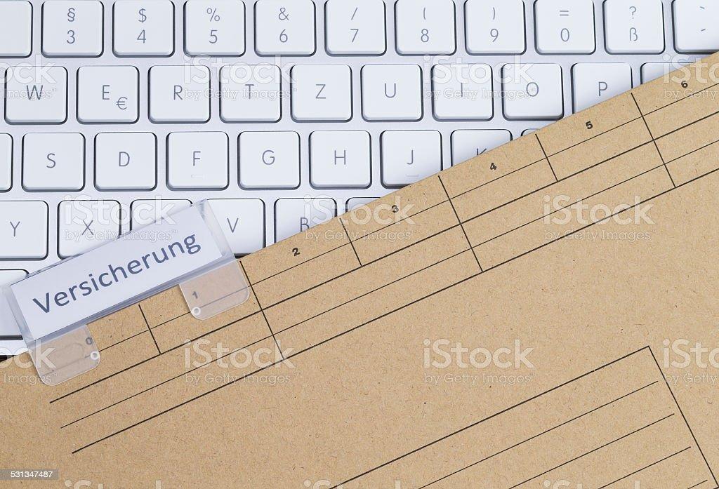 Keyboard and folder insurance stock photo