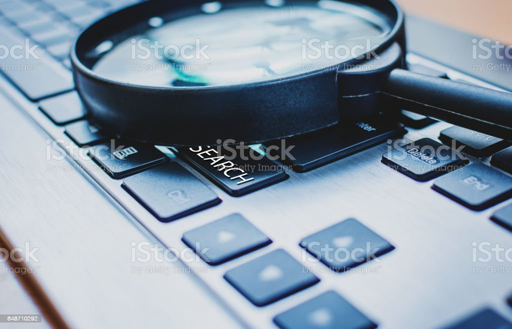 Keyboard and magnifier stock photo