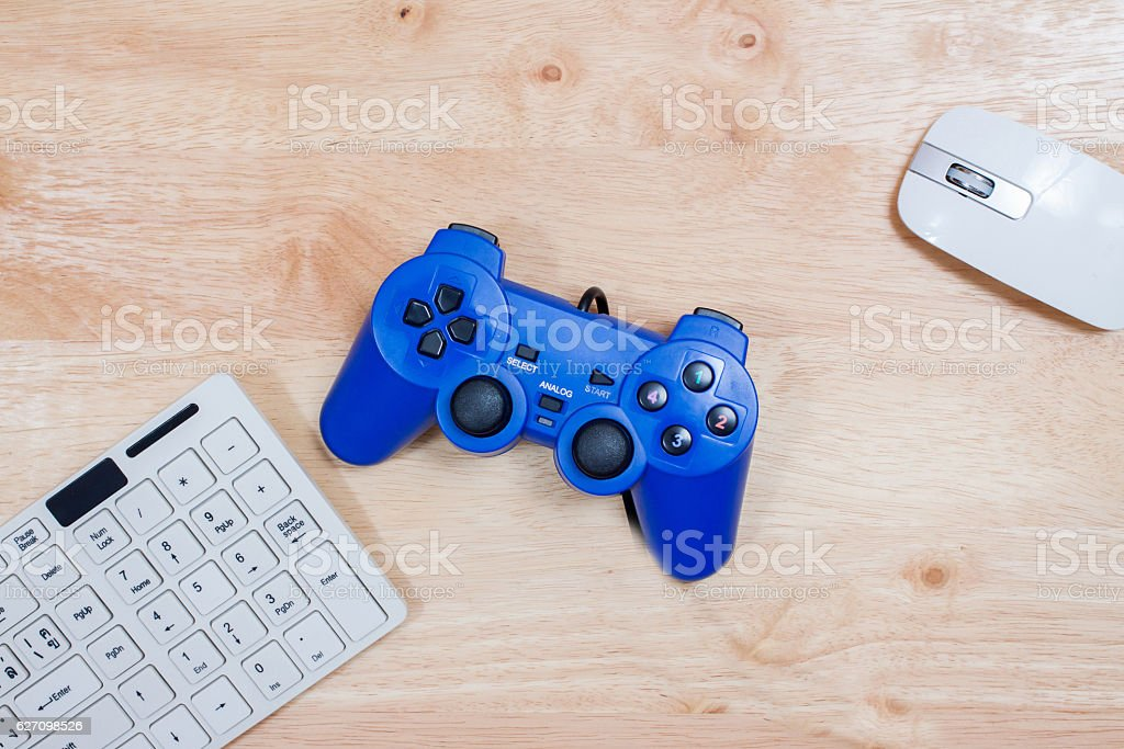 Keyboard and mouse on wooden table stock photo