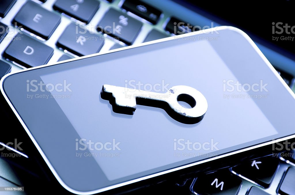 Keyboard and phone with a key set on top indicating security royalty-free stock photo