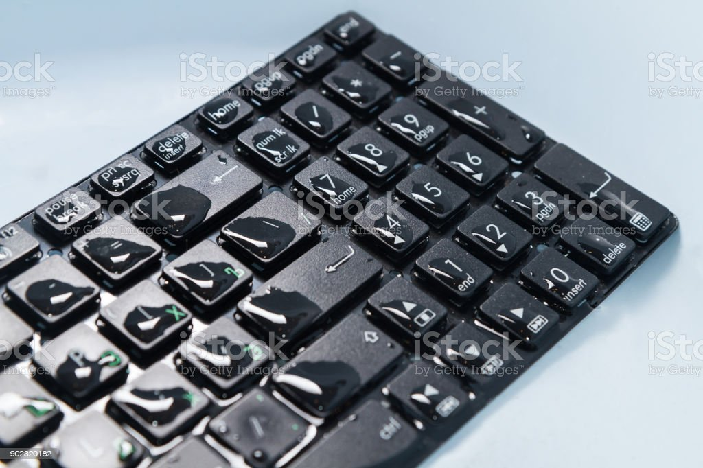 keyboard black water drops on the buttons, close-up angle stock photo