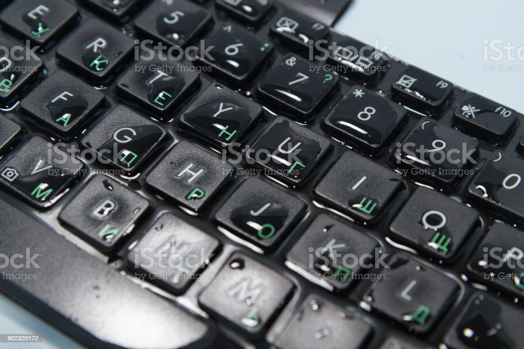 keyboard black water drops on the buttons, close-up stock photo
