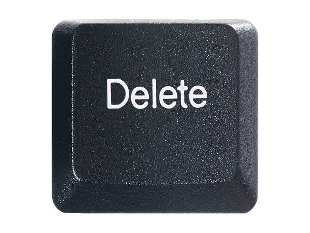keyboard delete key on a white background - delete key stock photos and pictures