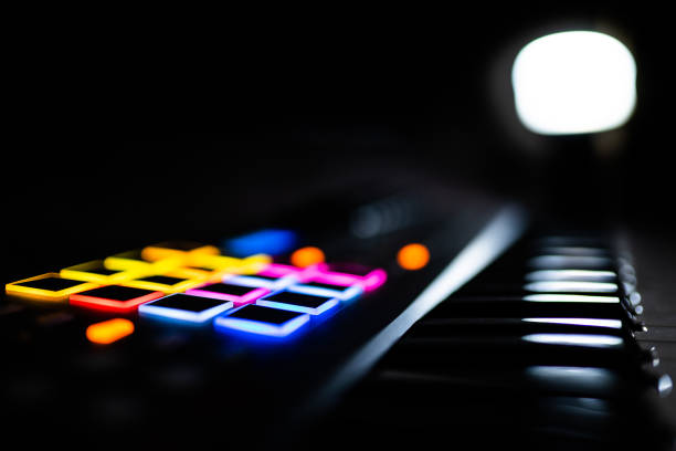Keyboard / electronical piano for recording music in a studio: drumpads / music pads Keyboard / electronical piano for recording music in a studio: drumpads / music pads electronic music stock pictures, royalty-free photos & images