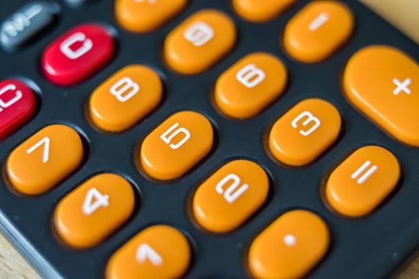 Keyboard of old pocket calculator stock photo