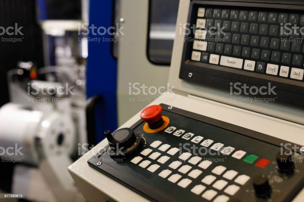 keyboard on a control panel of CNC machine stock photo