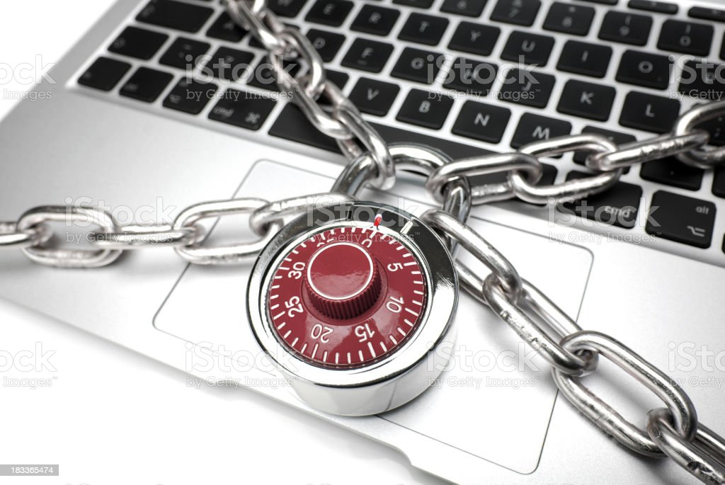 Keyboard portion of laptop chained and locked royalty-free stock photo
