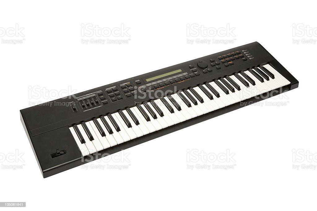 Keyboard synthesizer against white background stock photo