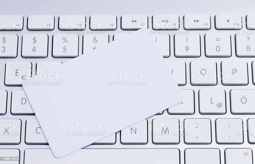 Keyboard with blank card stock photo