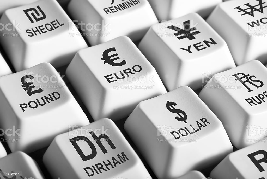 Keyboard with different money symbols keys stock photo