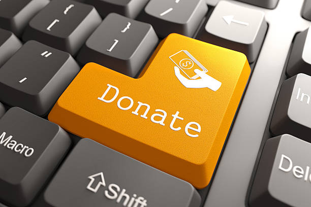 keyboard with donate button. - contributor stock pictures, royalty-free photos & images