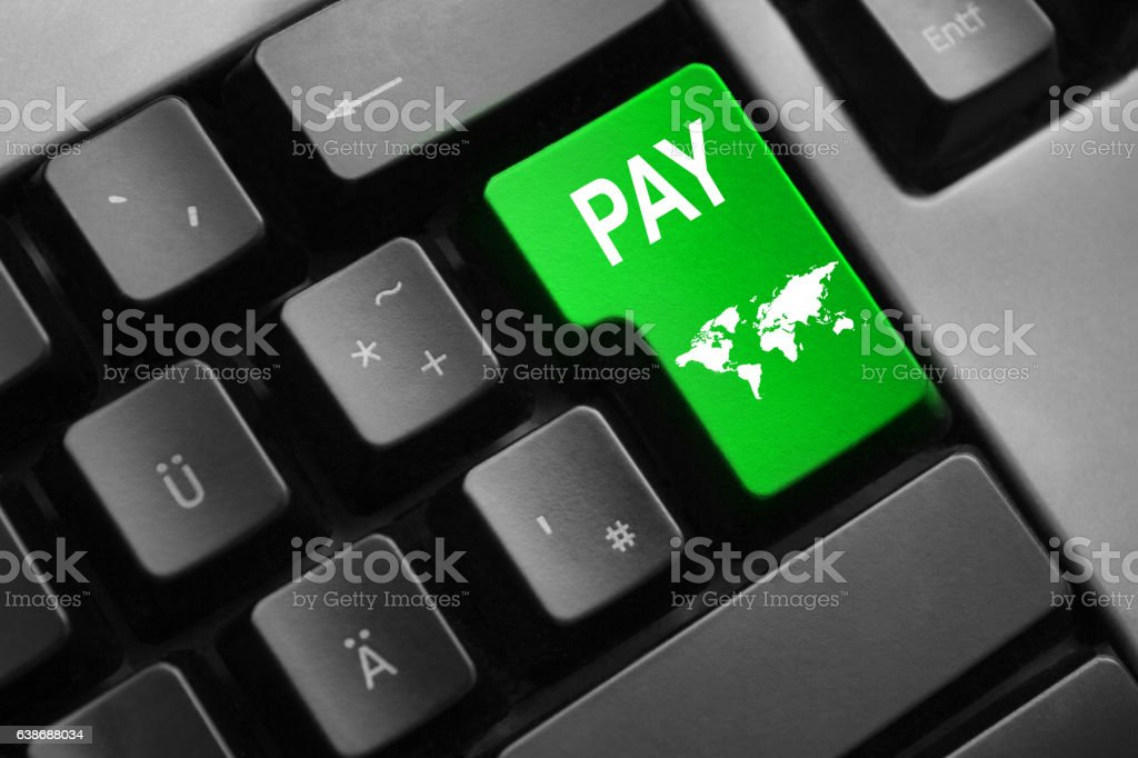 keyboard with green button pay world symbol stock photo