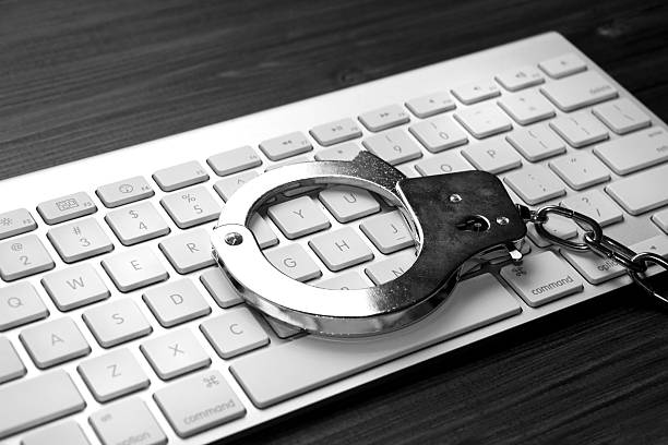 Keyboard with handcuffs stock photo
