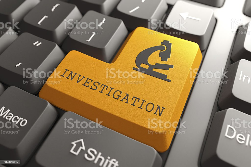 Keyboard with Investigation Orange Button. royalty-free stock photo