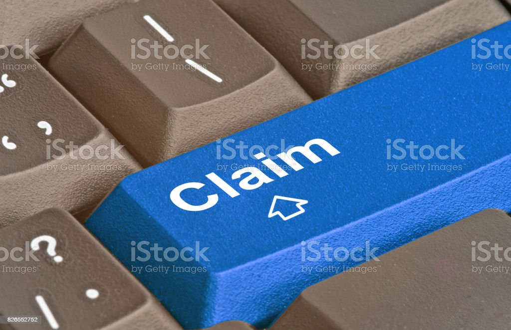 Keyboard with key for claims stock photo
