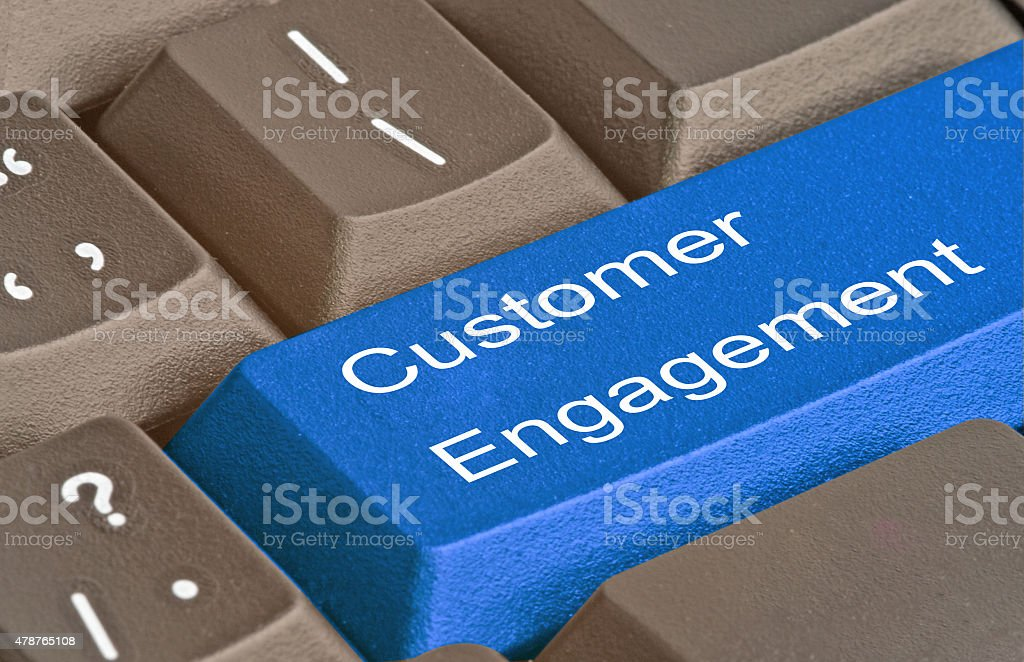 Keyboard with key for customer engagement stock photo