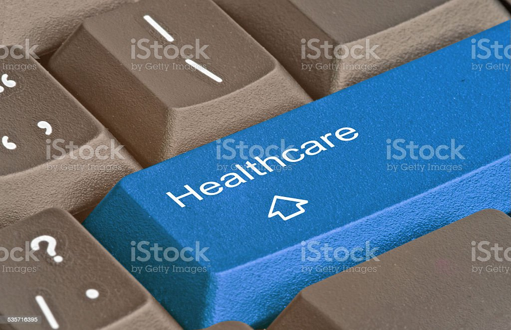 Keyboard with key for healthcare stock photo