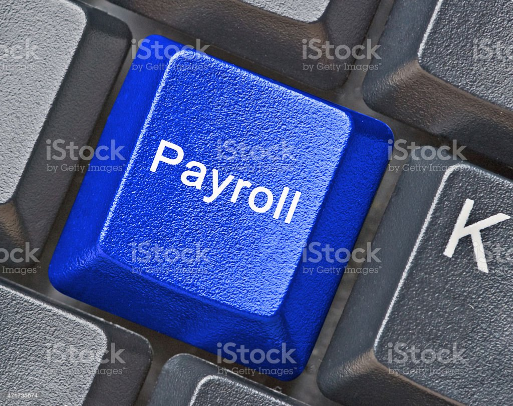 Keyboard with key for payroll stock photo
