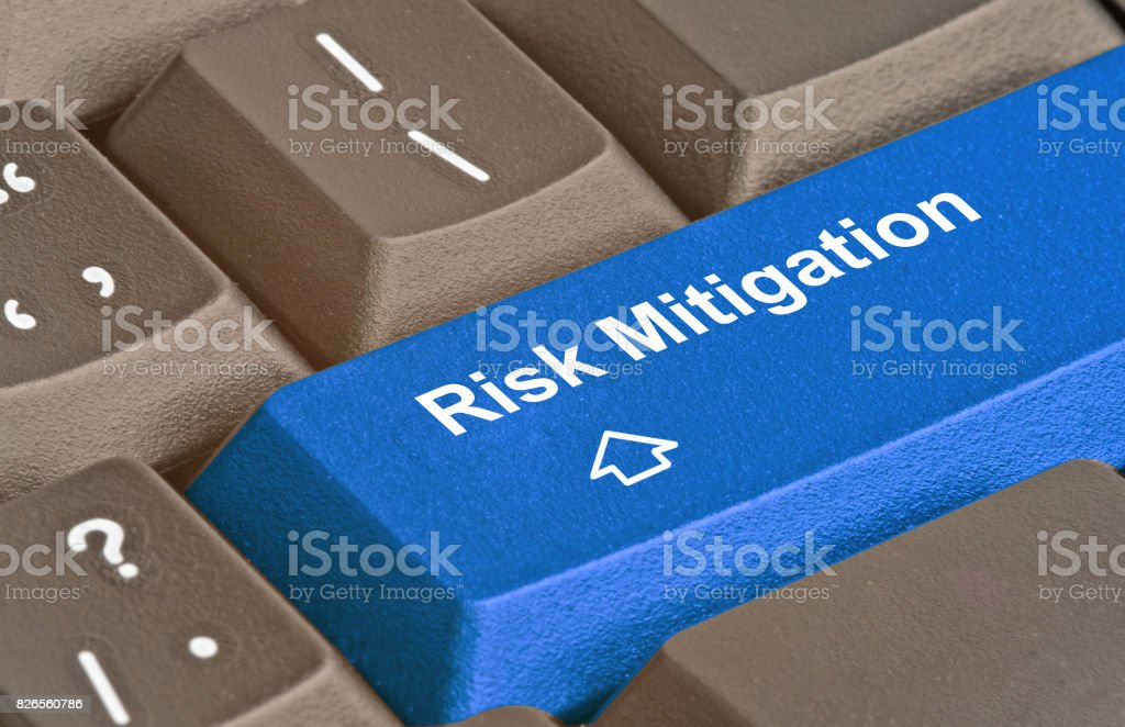Keyboard with key for risk mitigation stock photo