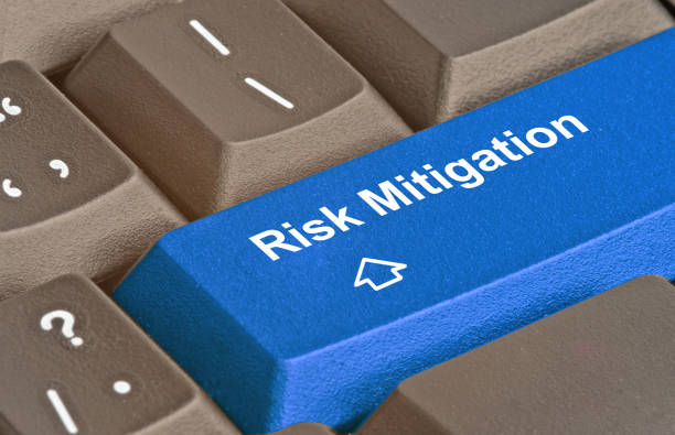 keyboard with key for risk mitigation - effortless stock photos and pictures