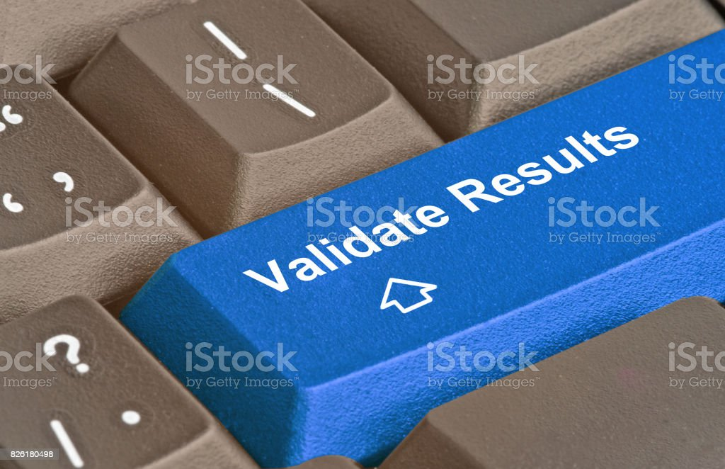 keyboard with key to validate results stock photo