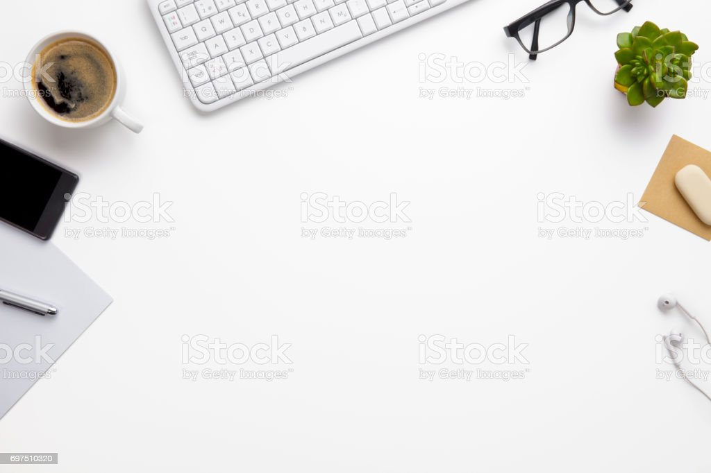 Keyboard With Office Supplies On White Desk stock photo