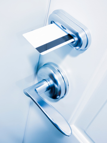 Electronic keycard door lock with magnetic stripe card key