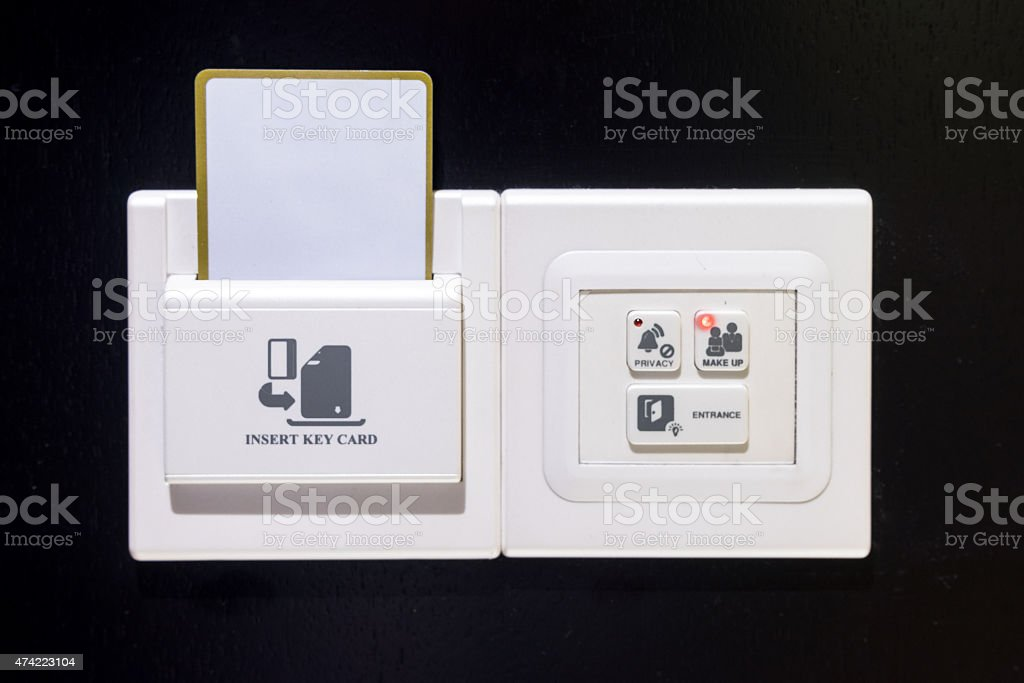 Keycard socket, entrance light, make up room, privacy in hotel stock photo