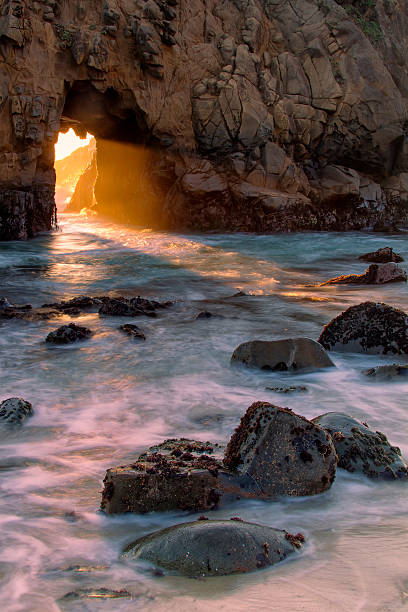 keyhole arch, pfeiffer beach - central coast california stock photos and pictures